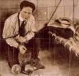 HAPPY 139th BIRTHDAY HOUDINI! (1874-1926) Harry Houdini, was born on March 24, 1874 in Budapest, Hungary. The Great Houdini was the legendary double-jointed magician who specialized in escaping from straitjackets, chains, handcuffs, ropes, trunks, jails, padlocked containers and milk cans underwater. He was a master of publicity stunts and famous for demystifying spiritualists and proving they were frauds. Houdini DIED on HALLOWEEN, in 1926!