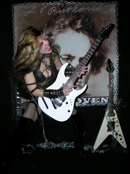 "PETER KEMP'S THEATRE REVIEW OF ""BEETHOVEN SHREDS"" CD! ""The Great Kat handles classical chords effortlessly, with razor sharp focus and plays her violin and guitars, incredibly faster than Beethoven would have had ever ventured to dream. She is an inspiration to us all. THE GREAT KAT THE FASTEST SHRED GUITAR FETISHIST."" - Naja Kemp, Peter Kemp's Theatre"