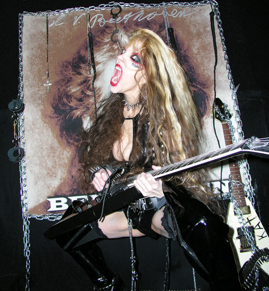 "METAL SERBIA'S INTERVIEW WITH THE GREAT KAT ""THE GREAT KAT - WORLD'S FASTEST GUITAR PLAYER""! ""The Great Kat - world's fastest guitar player. The Great Kat is known worldwide as an excellent guitar technician neoclassical / speed metal genre, but also for her high eccentricity.""-  Gisha and Marko Jovanovic, Metal Serbia"