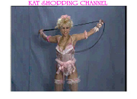"NEW ON YOUTUBE! KAT TV'S ""KAT SHOPPING CHANNEL"" from The Great Kat's ""DIGITAL BEETHOVEN ON CYBERSPEED"" CD-ROM/CD! Watch The Great Kat model the ""Kat Boudoir Outfit"" - with Pink Teddy, Bows and Whip!"