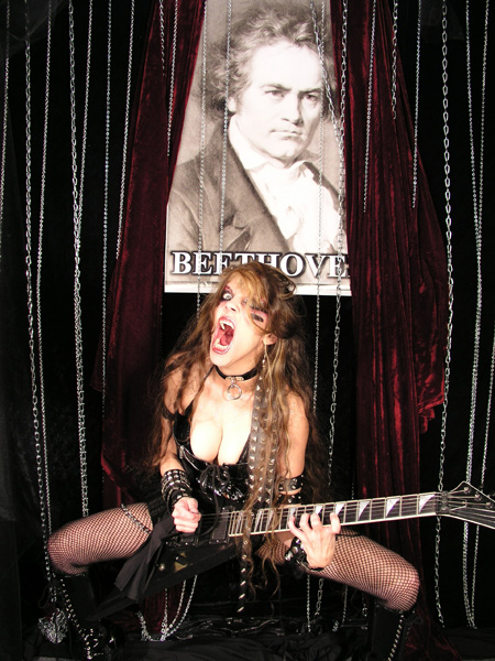 """ASSOCIATED CONTENT FEATURES THE GREAT KAT IN """"BIZARRE CELEBRITY & MUSIC COMPOSER COMPARISONS. Was MJ the Reincarnated Mozart? Bach, Slayer, Big (Great) Kat and Other Celebrity Comparisons""""! """"The Great Kat Priestess of the Guitar Shred and Beethoven. Great Kat, claimed to actually be a contemporary Ludwig van Beethoven, can perform some insanely crazy feats, including performing many of Beethoven's works at ridiculously mind-numbing speeds. Great Kat and Beethoven demonstrated incredible music accomplishments. (Great Kat actually holds a degree from Juilliard)."""" - Sabrina Young, Associated Content"""