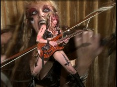 """AV MANIACS' REVIEW OF """"BEETHOVEN'S GUITAR SHRED"""" DVD! """"Kat has secured her position as the only classically-trained violinist-turned scantily-clad demonic guitar dominatrix and ambassador of the fine musical arts! Wow. It's difficult not to be bowled over by The Great Kat when she pretty much leaves you no alternative! Centering in on the universal male love of blood, cleavage and wickedly fast/intricate guitar displays. BEETHOVEN'S GUITAR SHRED, an ultra high-energy paen to Ludwig Van, J.S. Bach, Rimsky-Kosakov, that devilish Paganini, and of course, The Great Kat herself."""" - Ian Miller, AV Maniacs"""
