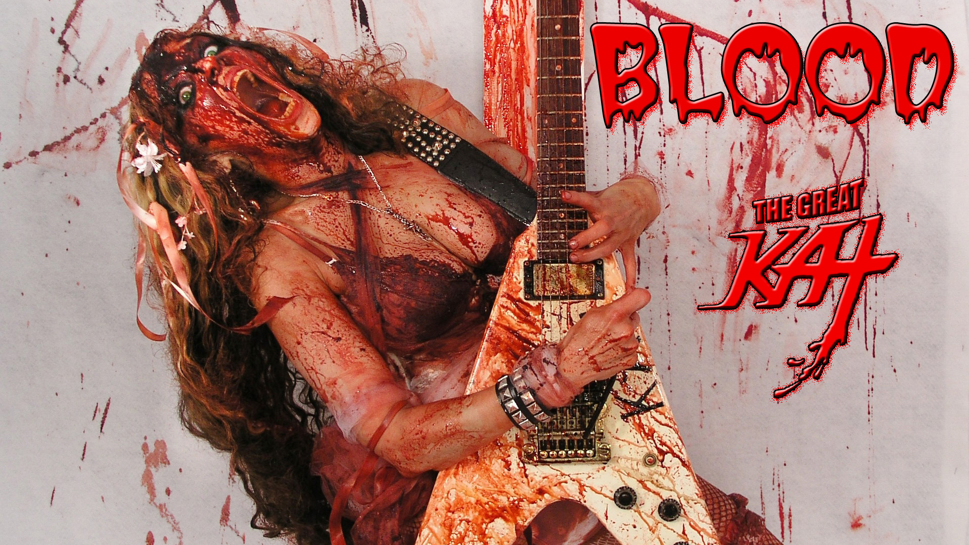 The Great Kat's BLOOD! BLOODY HORROR SHOW! Watch SHOCK ROCK Guitar Goddess The Great Kat's Insane Horror Show, featuring the hot female virtuoso's blood-dripping guitar shredding, heavy metal insanity & blood-curdling vocals. This is a total freak show with The Great Kat's finger-bleeding guitar virtuosity and outrageous stage persona in total bloody glory! The bloodthirsty immortal guitar hero, The Great Kat gargles blood while spitting out the insanely fast guitar riffs! Let the BLOODFEST begin!