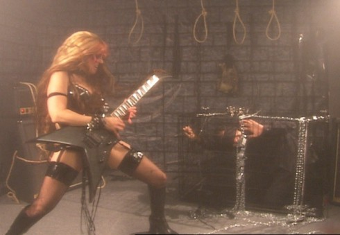 """CRUSHER MAGAZINE'S INTERVIEW WITH THE GREAT KAT! """"The queen of speed, the champion of all things shred and the uncontested ruler of humanity, a goddess who can play at speeds of 300bpm. The sheer ferocious power of The Great Kat's new Beethoven's Guitar Shred DVD has burned all feeble human minds to a cinder in the wake of Kat's invincible/truthful shred onslaught. This new bible for humanity has quickly left Kat as the dominant force on the planet Earth."""" - By Morgan Y. Evans, Crusher Magazine"""