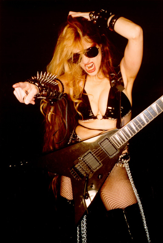 """The Great Kat. And now, the fastest of them all. Of all the female shredders listed here Juilliard-trained violinist the Great Kat is the most mind-bogglingly fast."""
