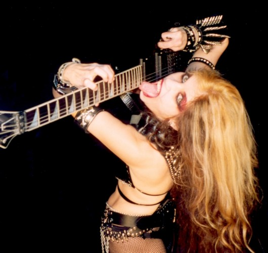 """VIRTUOSOS DE LA GUITARRA NAMES THE GREAT KAT """"MOST PROMINENT WOMEN ROCK GUITARISTS""""! """"The Great Kat. Her real name is Katherine Thomas and is known to have a very special talent for stringed instruments like the violin and guitar."""" -Virtuosos De La Guitarra"""