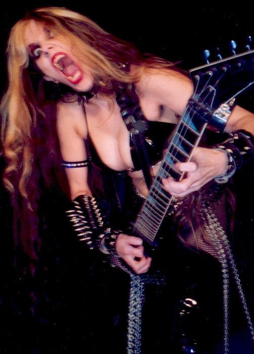 "AV MANIACS' INTERVIEW WITH THE GREAT KAT! ""An AV Maniacs Exclusive: 'Evil' Ian Miller Meets The Great Kat And Lives!"" ""The woman that I now believe is a dark superhero sent by the ghosts of composers past in order to make darn sure nobody forgets who they are, by any means necessary, the one, the only, THE GREAT KAT!!!!"" - By 'Evil' Ian Miller, AV Maniacs"