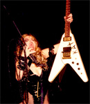 """THE GREAT KAT IN EXAMINER.COM'S """"MUSIC FANS CAN BID ON MEMORABILIA TO SUPPORT GRAMMY FOUNDATION AND MUSICARES""""! """"Flying V's are favorited by a wide range of guitarists, from ZZ Top's Billy Gibbons to the female guitar virtuoso The Great Kat."""" - Phyllis Pollack, Rock Music Examiner, Examiner.com"""