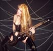 """MELODICGUITAR.COM FEATURES THE GREAT KAT IN """"GUITAR HERO, PART 2""""! """"The Great Kat is the stage name of Katherine Thomas, who is famous for Classical music interpretations in thrash metal music. Mostly she played with electric guitars, but sometimes she plays the violin. In fact Thomas was the coach of the violin, graduated from the Juilliard School and had a tour playing conventional classical music before finally crossing into metal."""""""