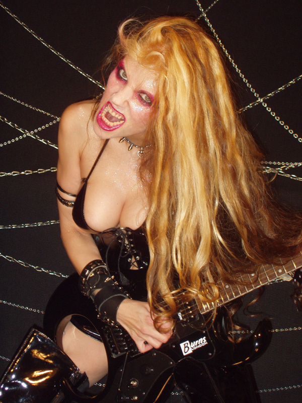 """HEAVY METAL: THE MUSIC AND ITS CULTURE"" BOOK FEATURES THE GREAT KAT IN ""MAKING THE MUSIC: METAL GODS"" - CHAPTER 3! ""The Great Kat. Trained as a classical violinist at Juilliard, Kat, who played at Carnegie Hall, is a speed-metal guitarist. Her style evokes the image of Paganini as a headbanger. Performing feats of technical virtuosity in her decollete leather and studs outfit."" - Deena Weinstein, HEAVY METAL: THE MUSIC AND ITS CULTURE"