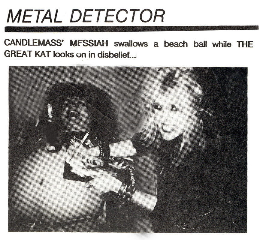 """Candlemass' Messiah WORSHIPPING The Great Kat Guitar Goddess while Kat Autographs """"WORSHIP ME OR DIE!"""" FROM FMQB! """"METAL DETECTOR: CANDLEMASS' MESSIAH swallows a beach ball while THE GREAT KAT looks on in disbelief..."""""""