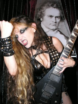 """HEAVY METAL EXAMINER'S REVIEW OF """"BEETHOVEN'S GUITAR SHRED"""" DVD! """"The Great Kat should be feared because her hyper-blasting, neo-classical, whirlwind guitar playing is so precise and intense. This woman really is a better guitarist than most men ever were. Beethoven's Guitar Shred DVD is a portable clinic of seemingly inhuman guitar antics.  Dominating torture, blood, fire, anti-terrorist sentiments – all wrapped in an oddly tasteful, hyper-classical visual feast."""" - Mark Morton, Heavy Metal Examiner"""