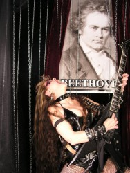"JASON.CON.CA'S INTERVIEW WITH THE GREAT KAT! ""The Great Kat: Guitar Heroine, Speed Metal Queen, Juilliard graduate, and one of the world's fastest guitarists. Besides her insanely quick playing, her trademark is that she loves to play classic pieces on her guitar. She's also quite terrifying."" - Jason MacIsaac, Jason.con.ca"