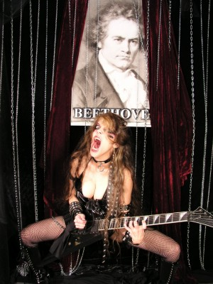 """NEW! FOUNDRYMUSIC INTERVIEW with THE GREAT KAT IN FOUNDRY'S POSTEROUS! """"Come one, come all, to see the stupendous interview with Classical Shred Guitar virtuoso The GREAT KAT. If you don't, she just might bite your head off and shit down your neck while shredding some classical music with her feet. The Great Kat is not the kind of woman you want to upset. Quite frankly, she scares the shit out of us."""" - FoundryMusicRob, Foundry's Posterous. Read Interview at FoundryMusic.com"""