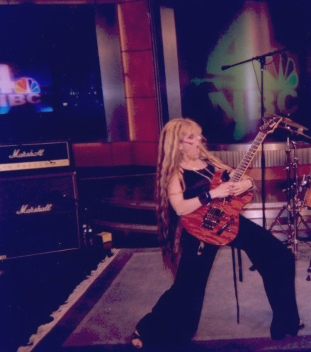 """The Great Kat performed """"The Flight of the Bumble-Bee"""" and Liszt's """"Hungarian Rhapsody #2"""" live on May 27, 2006 on NBC TV'S """"WEEKEND TODAY IN NY"""" TV Show and interviewed by Pat Battle as the """"World's Fastest Female Guitarist.""""!!"""