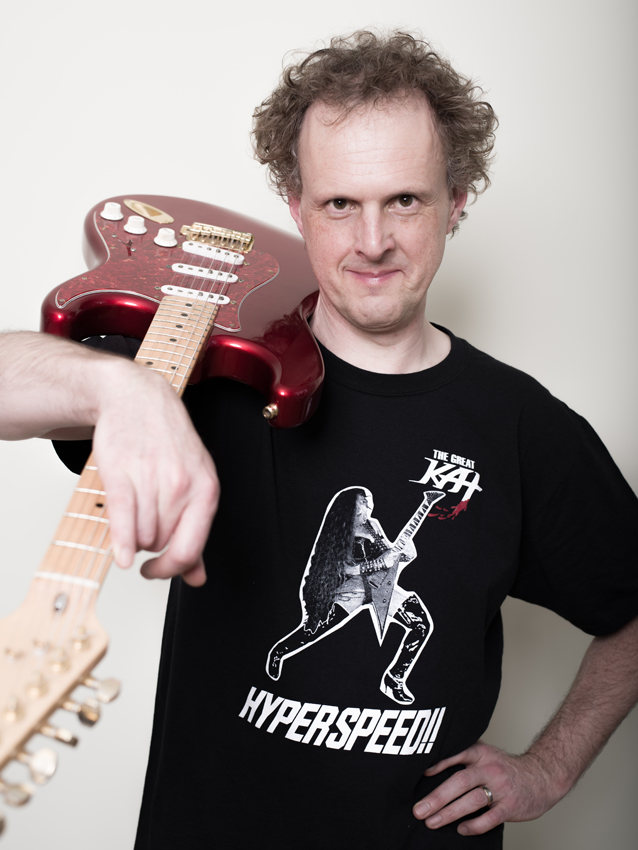 "BBC RADIO'S RAINER HERSCH wearing his Great Kat ""Hyperspeed"" T-Shirt, ready to Interview The Great Kat Guitar Shredder! AWESOME! Stay tuned for BBC Radio 4's ""FAST AND FURIOSO"" Great Kat/Rainer Hersch Interview Coming Soon!"