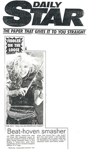 "DAILY STAR NEWSPAPER FEATURES THE GREAT KAT IN ""BEAT-HOVEN SMASHER""! FIDDLER ON THE LOOSE. THE KAT: ""Only me and Beethoven Matter"".Beat-hoven smasher. THE latest cross-over star from the classical scene to pop has created a stink in Britain after being banned from a live Radio 4 interview and then smashing up her record company offices in a rage."