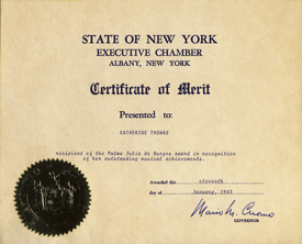 "New York Governor Mario Cuomo awarded The Great Kat (Katherine Thomas) the Certificate of Merit as ""Recipient of the Palma Julia de Burgos Award in recognition of her outstanding musical achievements"".   This certificate has the Seal of the State of New York and Governor Cuomo's signature. Katherine Thomas is the winner of the cultural award ""Palma Julia de Burgos Award"" from The Association for Puerto Rican - Hispanic Culture, Inc."