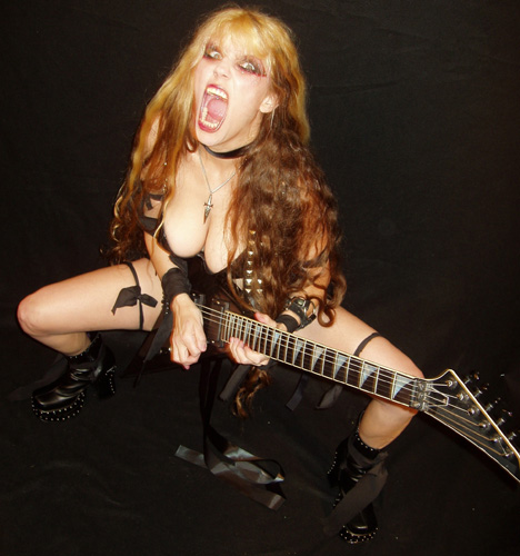 """VENEZUELA METAL FEATURES THE GREAT KAT IN """"GUITARS PLAYED BY GOD'S HANDS"""" """"One of the best guitarists in terms of command of the guitar, Katherine Thomas better known as 'The Great Kat'.  Undoubtedly, a girl with a big ego but extremely talented.""""- By Susana Garcia de Alonzo, Venezuela Metal"""