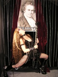 "HOME CINEMA CHOICE'S REVIEW OF ""BEETHOVEN'S GUITAR SHRED"" DVD! ""The Great Kat rises again as Beethoven gets the guitar shred treatment on DVD"" ""If you like heavy metal, distorted guitars and wild ladies in bondage gear, we have just about the perfect DVD for you - The Great Kat's Beethoven's Guitar Shred. Kat's 'shredding' style is based on her classical violin education, now put to use mangling the greats of classical music into a nerve-jarring aural assault of finger-blisteringly fast electric noise. It is something you'll want to watch over and over again, as much for Kat's scantily-clad, blood-spattered dominatrix stage persona as for her blistering performances."" - Chris Jenkins, Home Cinema Choice"