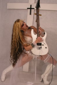 "THE METAL CIRCUS' INTERVIEW WITH THE GREAT KAT! ""THE GREAT KAT IS GOD! I AM THE REINCARNATION OF BEETHOVEN!"" ""The Great Kat, the virtuoso violinist and guitarist of metal who shreds all classical artists such as Beethoven, Paganini, Vivaldi, Mozart, Bach. She plays their parts at the speed of light. She is quite a character, genius and figure, but her extensive classical training allows her to reach extreme speeds that few are able to reach."" - By Jordi Zelig Tarrega, The Metal Circus"