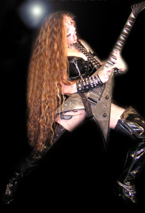 "ENTS24 FEATURES THE GREAT KAT! ""The Great Kat. AKA Katherine Thomas, a classical violin graduate of the famed Juilliard school, who has reinvented herself as a guitar shredder. She is believed to be the fastest female guitarist in the world."""