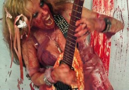 """CURRENT TV FEATURES THE GREAT KAT GUITAR SHREDDER! """"Did I mention that guitar slinging is a testosterone-driven thing?... Which is why the music of the Great Kat is such an unique, inevitable and astounding accomplishment. The Great Kat is a female, heavy metal shredder of unquestionably advanced technical proficiency and speed on her instruments (she also plays violin at a virtuoso level)."""""""