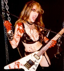 "RIZMUM BLOG NAMES THE GREAT KAT ""GUITARIST OF THE MONTH"" (APRIL 2010)! ""Guitarist of the Month. April is the month for The Great Kat. She is a composer, musical revolutionary and a musician best known for her thrash metal interpretations of well-known pieces of classical music."" -  RizMum, RizMum Blog"