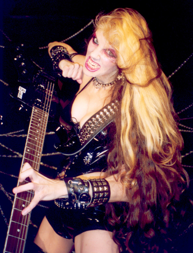 "THE OTHER VIEW'S REVIEW OF ""BEETHOVEN'S GUITAR SHRED"" DVD! ""The Great Kat hardcore metal musician with some serious shred, I'm talkin bloody fingers fast dudes. She takes classic tunes and mixes it up with some metal and produces one unique, fast-paced sound. There's nothing like seeing a woman spread wide with a guitar between her legs. If you're a fan of heavy metal then definitely take The Great Kat's Beethoven's Guitar Shred for a spin; it's a unique spin on classic hits that's sure to please. It's been Valkor tested and TOV Approved."" - By Valkor, The Other View"