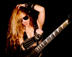 """The Great Kat: She's loud...She Shreds...She talked to Tommy & Rumble""-FM 99 Radio!"