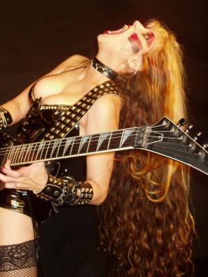 """HOUSTON PRESS INTERVIEW WITH THE GREAT KAT! """"The Great Kat: From Juilliard To Shred Goddess""""! """"Kat is a Juilliard-trained violinist who traded in the sedate world of classical performance to play the guitar just shy of the speed needed to go back in time.  Kat forces these melodies through a black hole and back out again through in a white-hot stream of incredibly fine sound particles that ascend and descend so quickly and accurately that one could debate whether the interpretations are a performance or a weapon. For those who have thus far enjoyed the carnival ride of Beethoven Shreds should have no problem putting Kat's statue alongside the greats."""" By Jef With One F, Houston Press"""