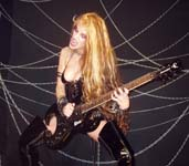 "GUITAR WORLD MAGAZINE NAMES THE GREAT KAT ""50 FASTEST GUITARISTS OF ALL TIME""! ""The Great Kat. SIGNATURE SONG: 'The Flight of the Bumble Bee'. Juilliard-trained virtuoso. Heavy leather dominatrix persona so over the top."" - Guitar World Magazine"