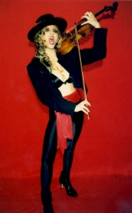 "BOW! To the HOT Metal Goddess The Great Kat! The Great One is about to BLAST OPEN YOUR LETHARGIC, DUSTY BRAINS with TOTAL SHREDDING CLASSICAL VIRTUOSITY of the FAMOUS GYPSY VIOLIN VIRTUOSO PIECE: ""CSARDAS""!!! Stay tuned OH-YE-KAT-POSSESSED SLAVES to the Kat web site for CD RELEASE INFO!!!"