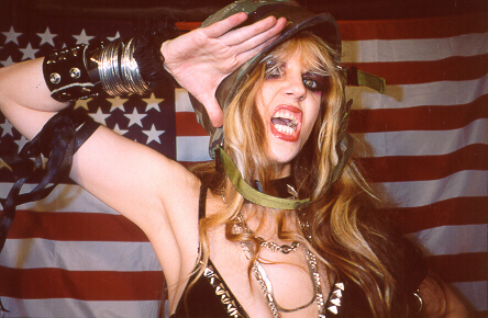 "SOUTHERN FRIED GAMER'S REVIEW OF ""WAGNER'S WAR"" CD! ""CONDUCTOR, CAN'T YOU MOVE YOUR ASS ANY FASTER!"" ""She is a violin virtuoso, and Juilliard graduate. She is The Great Kat, one of the fastest, face melting guitarists of all time. Wagner's 'The Ride of the Valkyries' an instantly familiar song to anyone who hears the famous melody. The production value astounded me. There about a million different things going on at mind boggling speeds. It was amazing how good it sounded. It is not just your average shred guitar, there is a full orchestra of sounds backing her, and when she pulls out the violin it is amazing. Musically the album is great. An all around winner."" -Will C., Southern Fried Gamer"