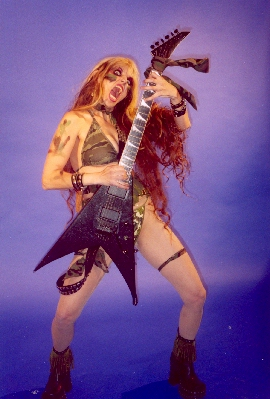 """UNCONSCIOUS AND IRRATIONAL BLOG FEATURES THE GREAT KAT! """"As far as metal babes go, The Great Kat wins for being all around unruly."""""""